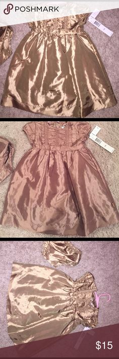 Brand New DKNY formal toddler dress Beautiful Gold 18 month toddler formal dress with matching bloomers.  Tags attached. DKNY Dresses Formal