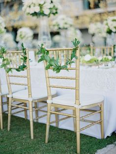 Gold and white Grecian-inspired wedding table decor with delicate chair wreaths {Facebook and Instagram: The Wedding Scoop}