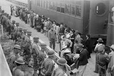 Japanese-American internees arrive by train from San Pedro at the Santa Anita assembly center, by Clam Aubers (April 5, 1942)