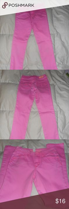 Justice Neon Pink Jeans  12 Slim These are in good used condition from a pet and smoke free home.  These are a 12 Slim Justice Bottoms Jeans