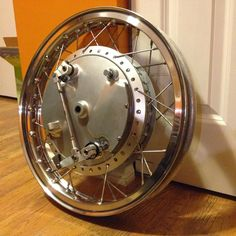 I finally got this wheel together, its been a long time coming. Im feeling pretty good about it, the rims got some battle scars but they pol...