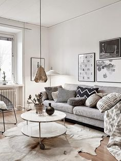 77 Gorgeous Examples of Scandinavian Interior Design. 77 Gorgeous Examples of Scandinavian Interior Design Neutral-Nordic-living-room-with-copper-light-feature. Nordic Living Room, Scandinavian Living, My Living Room, Home And Living, Living Room Decor, Modern Living, Scandinavian Christmas, Cow Hide Rug Living Room, Scandinavian Cushions