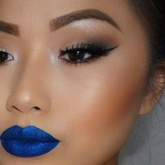 Winged eyeliner perfection with bold blue lips