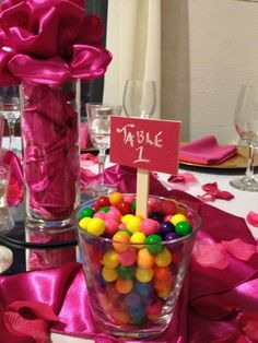 Fill a vase with candy and add a table number! Great ways to add colour and edibles to the guest tables.  Beauty Bride can custom your tables numbers and candy treats to your bridal theme www.beautybride.ca