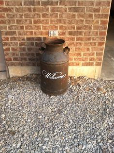Welcome decal on old milk can- would be great with something planted in it