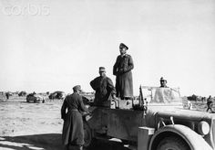 Somewhere in North Africa: Hellmut von Leipzig behind the wheel of Rommel's Horch staff car, with the Field Marshal standing in the back.