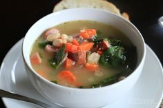 A hearty homemade White Bean Soup made with Spinach and Turkey Sausage. This soup is creamy and light !