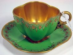 COALPORT GREEN GUILDED DEMI CUP AND SAUCER