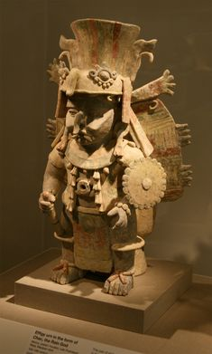 The photograph above is of an effigy urn in the form of Chac. Mexico, eastern Yucatan, Late Postclassic Maya, Mayapan style. Earthenware and...