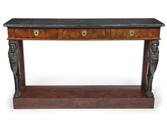 A large Empire ormolu mounted, carved and ebonised mahogany console table, in the mannor of Bernard Molitor, France, 1st third 19th ct. Belgium granite top. Rest., minor damages
