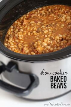 Ditch the canned baked beans and try this crockpot version instead. These crockpot baked beans are delicious, addicting, and so easy to make. Meet the perfect summer BBQ side dish. Baked Beans Crock Pot, Slow Cooker Baked Beans, Homemade Baked Beans, Baked Bean Recipes, Slow Cooker Recipes, Crockpot Recipes, Beans Recipes, Side Dishes For Bbq, Side Dish Recipes