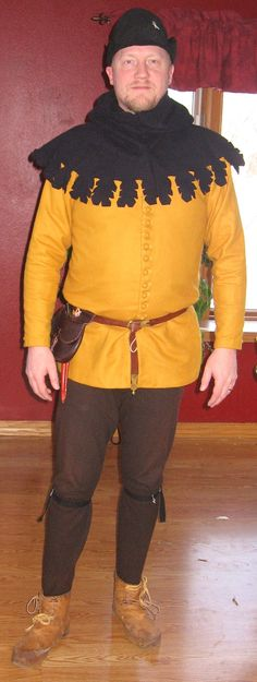 Another mid to late 14th century nobleman portrayal.  This is a wonderfully tailored cotehardie, BUT, it is not long enough.  A mistake I made with giving Medieval Design my measurements.  Yes, men's braies (underwear) did show a bit beneath a cotte like this, but this length would have shown all of my braies.