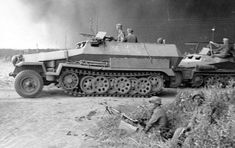 SdKfz 251 and SdKfz 250 pass troops