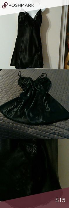 Fredericks of Hollywood negligee Black satin gown with spaghetti straps that cross in back.  There is large v in back.  Lace is on bodice and the bottom of the front slit.  No stains, tears or holes.  Non smoking home. Fredericks of hollywood Intimates & Sleepwear