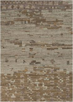 This flat weave rug is a perfect blend of earthy colors in a modern, yet very organic feel. It would look amazing paired with some mid-century modern furniture. From the Rustic Collection by Surya. (RUT-700)