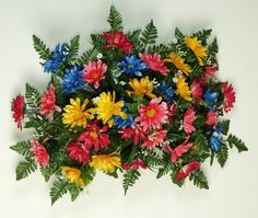 """29"""" Deluxe Gerbera Headstone Spray - Fuchsia/Blue/Yellow/Pink by Teters. pict.com/p/BBw"""