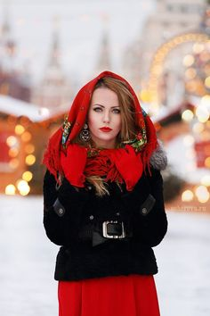 Russian girls. Russian beauty. Shawl, headscarf. Winter fashion, Russia, Moscow background.