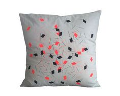 Geometric pattern cushion printed on both sides (white with black and neon orange print)
