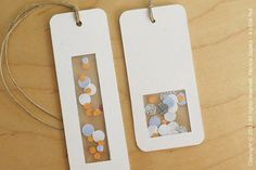 Recycle bookmarks.  Made with leftover envelope windows, puched out security paper from envelope.