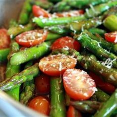 "Asparagus and tomatoes. Previous pinner said ""I made this exactly like the recipe, thinking it would be a bit simple and bland. Boy was I wrong! Sometimes simple ingredients can equal big taste."""