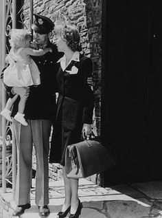 Ronald Reagan with wife Jane Wyman and their daughter Maureen, saying their goodbyes as he prepares to leave for the army.