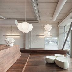 Suspension lamp providing diffused light. White powder coated internal steel structure sprayed with a unique cocoon resin to create the diff user which is then protected by a transparent sprayed on finish.