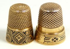 """Gold thimbles. Etched, black enamel floral border with a monogram of """"Louise"""". Etched floral black enamel border with a monogram of """"MIJC 1872""""."""