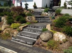 This eye-catching Long Island driveway done by J Ratto Landscaping was created with:  Pavingstones: ON RT 6x9 with Onyx borders  Steps: Cast Stone Steps