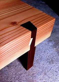 Leg detail on a redwood plank low table. I love the leg setup with a sliding through dovetail shape. Minimalistic. Beautiful. Sturdy.