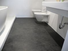This floor was covered with a layer of dyed Ardex, then ground smooth.