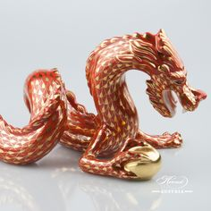A Herend Dragon figurine 15601-0-00 VH-OR - Special Red and Gold. Painted with a special golden fishnet decor. I do not want to say Dragon Ball but this traditional oriental dragon really has one!