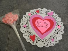 Parents and grandparents would love a handmade Valentine created with love, way more than any store bought card or gift you could give.    Here's an idea for an easy handmade heart shaped Valentine with a paper doily as the background. I used cookie cutters to make the larger heart shapes, but you could also use die cut hearts, or print out your own heart pattern.