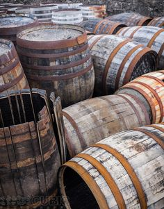A collection of old used whisky barrels outside a distillery on Islay, Scotland