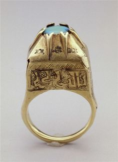 Ring (inscriptions means Blessing) gold and turquoise 1100's AD Iranian