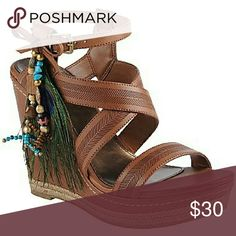 Call It Spring Newhouse Wedge Sandals Adjustable buckle closure at ankle strap. Faux leather upper with peacock feather & colorful beaded accent at ankle. Charming bow detail adds the perfect amount of feminine flair. Man-made lining. Lightly cushioned man-made footbed. Wrapped platform and wedge heel. Man-made sole. Imported. Heel Height: 4 1 ? 2 in. Platform Height: 1 1 ? 4 in. Brand: Call It Spring Size: 8 RP: $40.00 NWoT Call It Spring Shoes Wedges