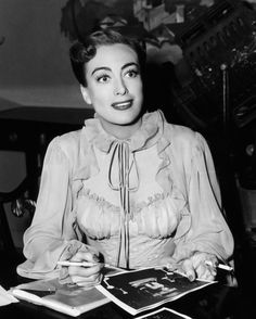 Joan Crawford signing autographs on the set of Harriet Craig