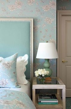 Edging a bit more traditional than my usual desires... however the extra height headboard and the tone on tone on tone of similar sharp blues and greens gives this space a rich freshness