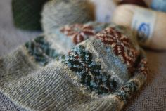 I like both the original Green Memories pattern and this revised colorway by oldraptorfarm on Ravelry