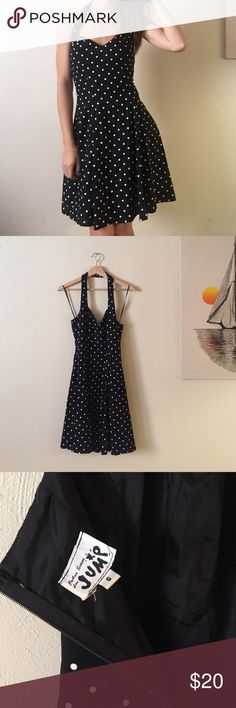 Vintage Black Polka Dot Dress Vintage black Polka dot Halter dress. Size 6! No flaws. Zips up the back. Bundle any two or more items for 20% off your total price! I'm always willing to negotiate. All items come from a pet/smoke free home. Please feel free to ask questions🌻 vintage Dresses Midi