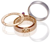 Singapore Jewelry Design Awards Secret Ring, opens up to a secret compartment that fits in a band, with rubies , set in 750 rose gold with a detachable 750 white gold band.  By Liu Shu Jin  Student at: Panyu Polytechnic