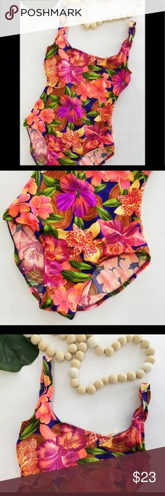 """Vintage 80s Floral Hibiscus Swimsuit Bodysuit Vintage Jantzen Swimsuit   Size 10. Dark purple background with bright neon floral print. One piece. Shelf bra. Made in the USA   86% polyester and 14% spandex   16"""" underarm to underarm  30"""" bust  26"""" waist  28"""" overall length. All measurements taken unstretched   Excellent condition. No stains, tears, or holes. Smoke free environment. Jantzen Swim One Pieces"""
