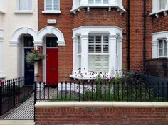 red garden brick wall london rail and gate victorian black and white mosaic tile path balham london (5)