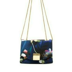 """NWT Ted Baker Mini Fabea Antonya Crossbody Clutch - Laced chain shoulder strap - Foldover front flap with magnetic closure - Allover floral print - Interior features zip wall pocket and 3 credit card slots - Approx. 4.5"""" H x 6.25"""" W x 2"""" D - Approx. 22"""" strap drop Ted Baker Bags"""