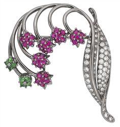A pink sapphire, tsavorite garnet and diamond brooch #christiesjewels #flowers