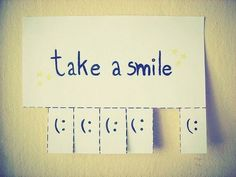 (smile,paper,take one)