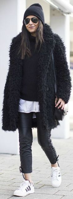 Laura Dittrich + crazily cool + black yeti coat + H&M + leather leggings + lace up detailing + Adidas sneakers + totally badass Coat/Leggings: H&M, Sweater: Everlane, Shirt: SET, Shoes: Adidas Superstar. Fluffy Coats Outfits!