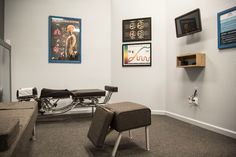Wall art should be educational. We custom made the poster on the far right to educate our patients on what to do before the doctor enters the room and after their specific scientific chiropractic adjustment. The multi-functional modern box on the wall under the touch AIO computer holds an keyboard on the top, bilateral spinal temperature detection instrument inside along with a condyle block. #diy #affordablebuilding #gonsteadchiro #industrial