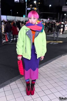 Jan 2014: Nonoko is wearing a fuzzy neon Patricia Field jacket over an orange Patricia Field top, a striped House of Holland midi-skirt, polka dot socks, and chunky red velvet platform heels from UNIF. Accessories include a color block knit scarf, silver rings, an Ambush eyeball ring, several earrings from MYOB, and a House of Holland houndstooth clutch.
