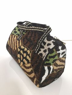 """Beaded Tribal Barrel Bag beaded Animal print by TocaNycFashion Use coupon code """"GraciasToca"""" for 10% off at check our in our three Vintage Etsy stores: https://www.Etsy.com/shop/TocaNycFashion   https://www.Etsy.com/shop/TocaNycJewelry  https://www.etsy.com/shop/TocaNycStore"""