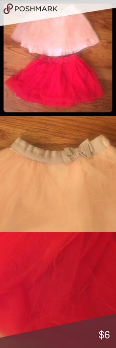 Two cute skirts Super cute!! Bow at waist. A little pull at bottom tulle of red one. Can't see it. Size 6. Red and light pink Carter's Bottoms Skirts